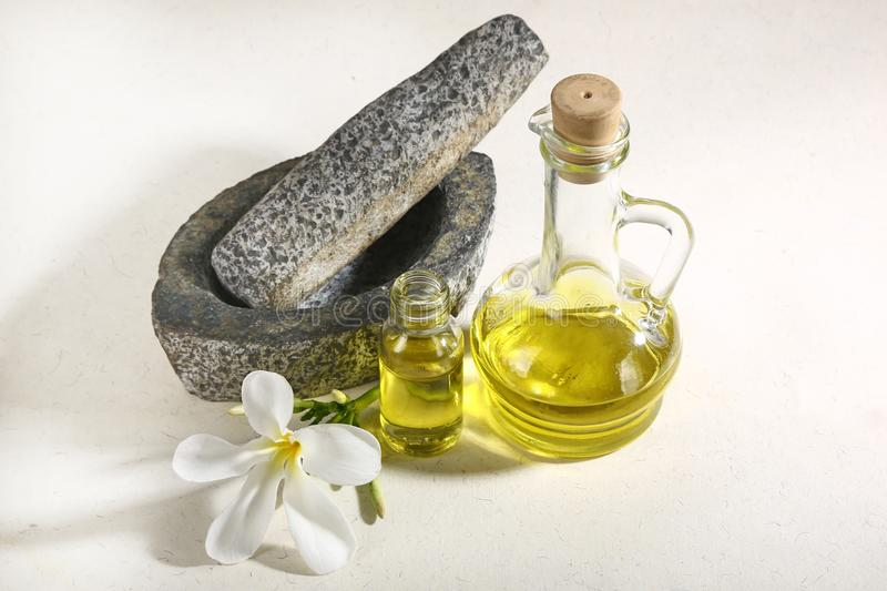 Ayurvedic Oil in Glass Bottle or Herbal Hair Oil with Herbs.  royalty free stock photo