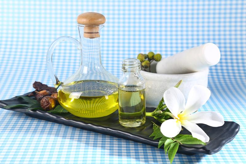 Ayurvedic Oil in Glass Bottle or Herbal Hair Oil with Herbs.  royalty free stock photos
