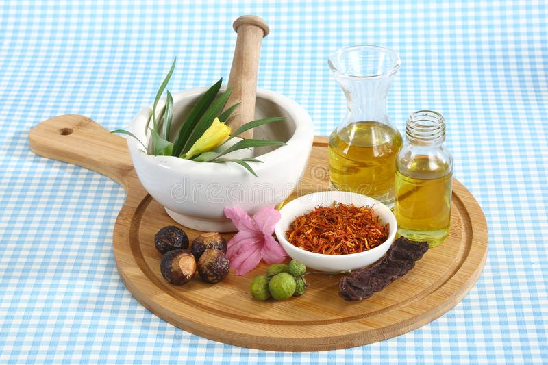 Ayurvedic Oil in Glass Bottle or Herbal Hair Oil with Herbs.  stock photography