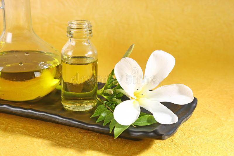 Ayurvedic Oil in Glass Bottle or Herbal Hair Oil with Herbs.  stock images