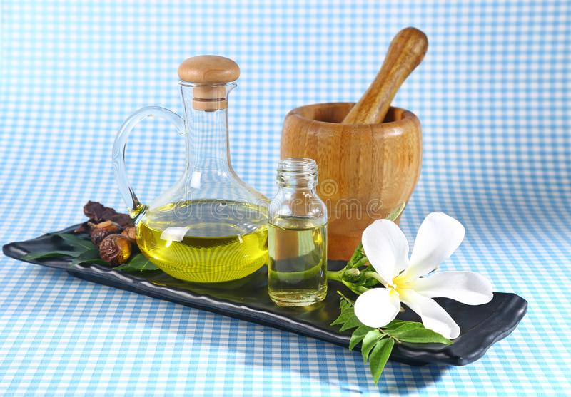 Ayurvedic Oil in Glass Bottle or Herbal Hair Oil with Herbs.  stock image