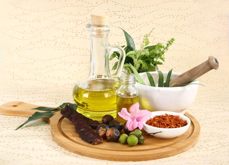 Ayurvedic Oil in Glass Bottle or Herbal Hair Oil with Herbs.  royalty free stock images