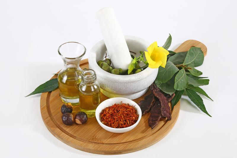 Ayurvedic Oil in Glass Bottle or Herbal Hair Oil with Herbs.  royalty free stock photography