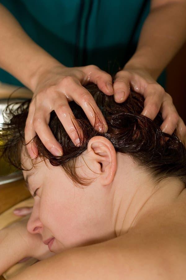 Ayurvedic oil massage. Young woman on the ayurvedic aromatherapy oil massage procedure royalty free stock photography