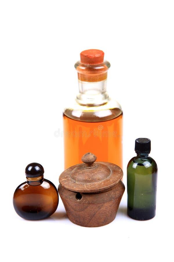 Ayurvedic oils. Ayurvedic oil bottles over white background royalty free stock photography
