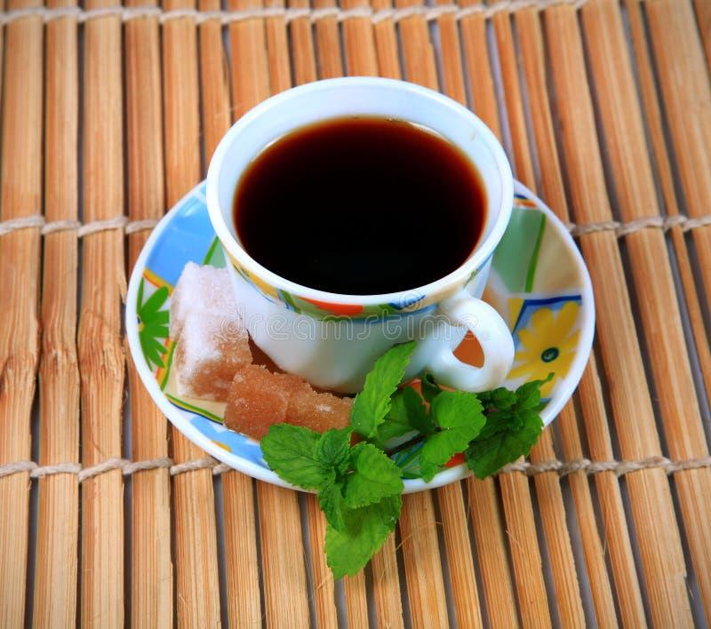 Ayurvedic tea. Cup of ayurvedic tea with wooden background stock images