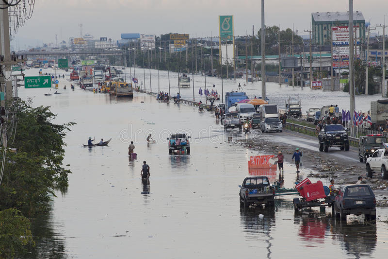 AYUTHAYA THAILAND - OCTOBER 14,2011 : flood water attack on phahonyothin road cutting main of land transport to north of country stock images