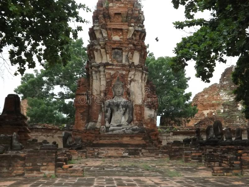 Ayutthaya, buddha temple, ancient ruins. Face in the tree, Ayutthaya, bangkok, ancient ruins, buddhist temple stock photo