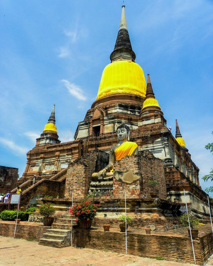 June 2011 Ayutthaya, Thailand - Buddhist temple with yellow cloth adorning the staues. stock photos