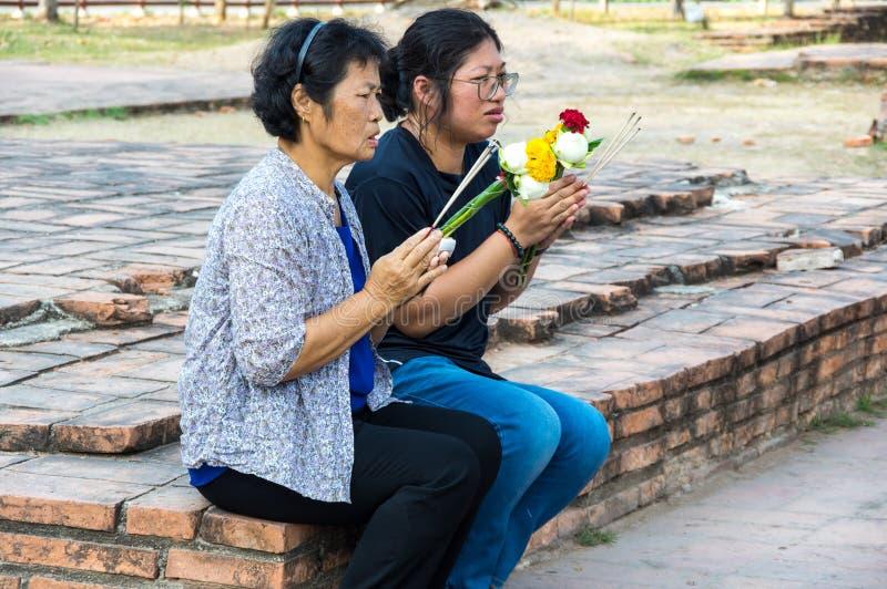 Thai women praying royalty free stock image