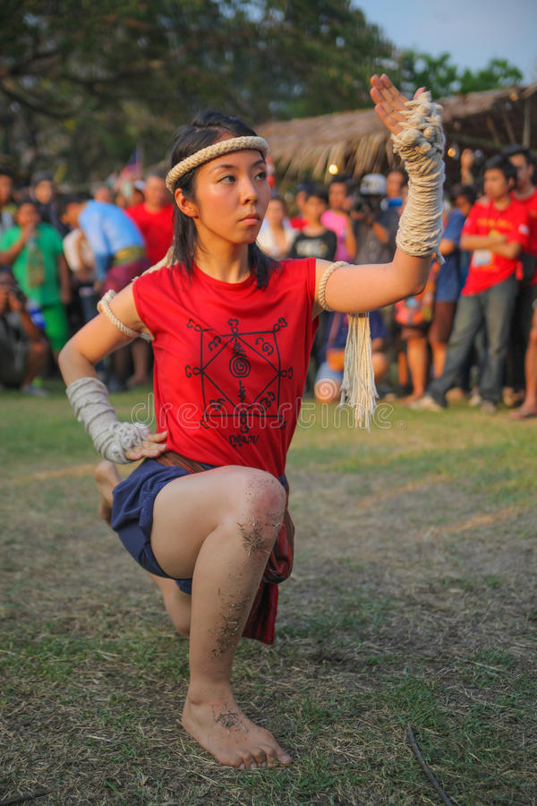 AYUTTHAYA,THAILAND-MARCH 17,2013 : Female Asian wooman shows spiritual dance on Wai Kru Muay Thai Ceremony. Spirit possession during the Wai Kroo in The Wat stock images