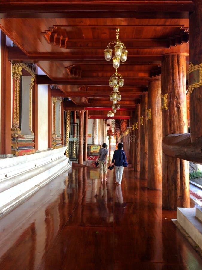Visitors walk around the Wat Phanan Choeng temple. AYUTTHAYA,THAILAND-NOVEMBER 24, 2018 : Visitors walk around the Wat Phanan Choeng temple royalty free stock photography