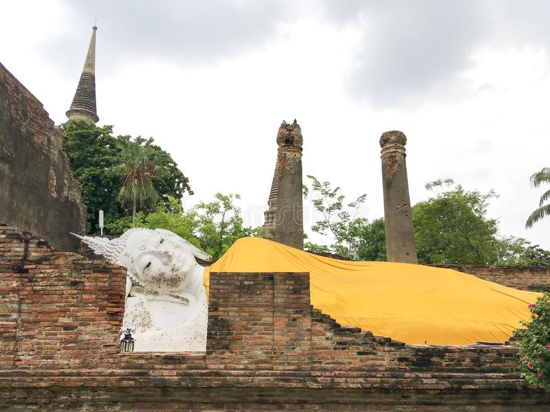 Ayutthaya,Thailand:Reclining Buddha turned his face to the east.The old body that had been destroyed by adventurer dig out. royalty free stock images