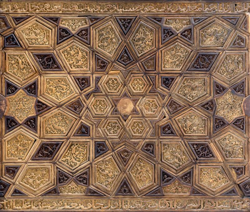 Ayyubid style panel with joined and carved wooden decorations of geometric and floral patterns royalty free stock photos