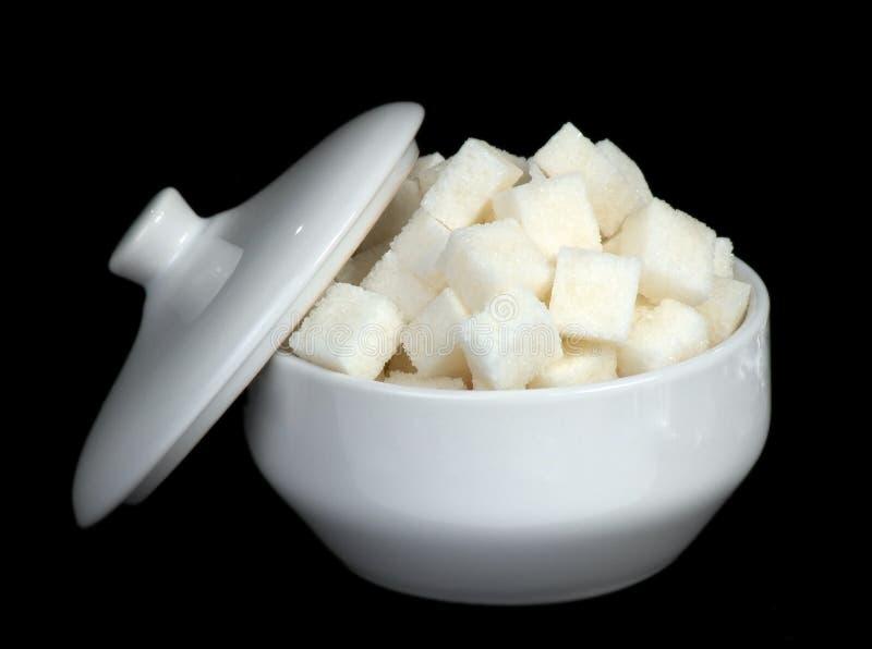 Azúcar de una remolocha en un azúcar-tazón de fuente imagen de archivo