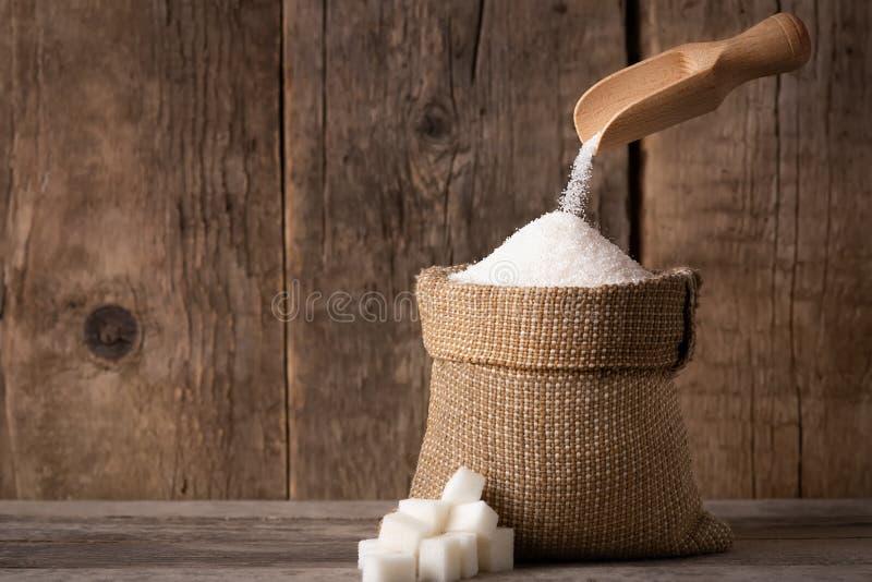 Azúcar en saco de la arpillera foto de archivo libre de regalías
