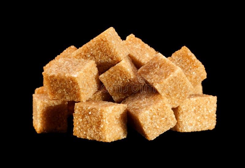 Azúcar marrón cubierto con paja foto de archivo