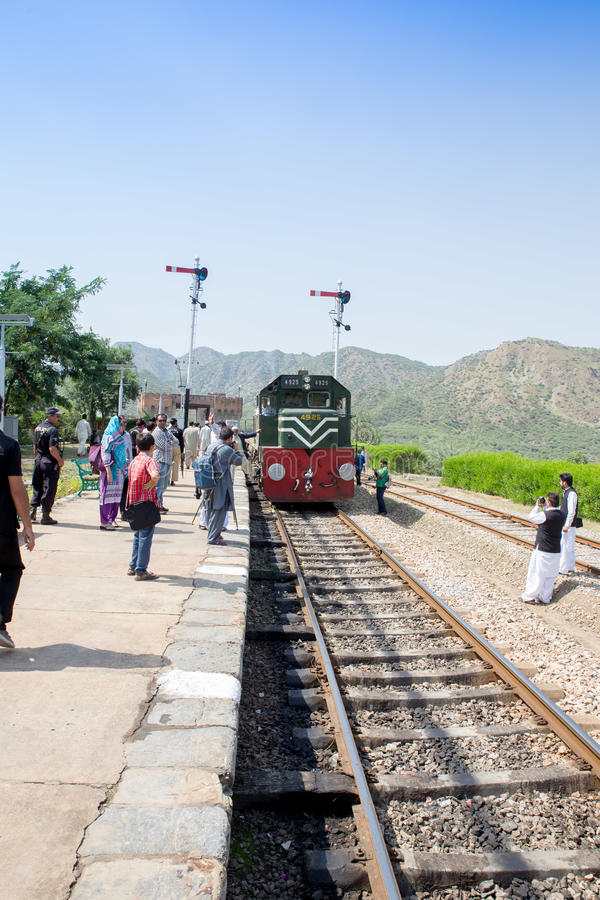 Azadi train coming bag travel to Peshawar and same Young Photographer take Picture. Swabi, PAKISTAN - Sept 27:Azadi train coming bag travel to Peshawar and same stock photography