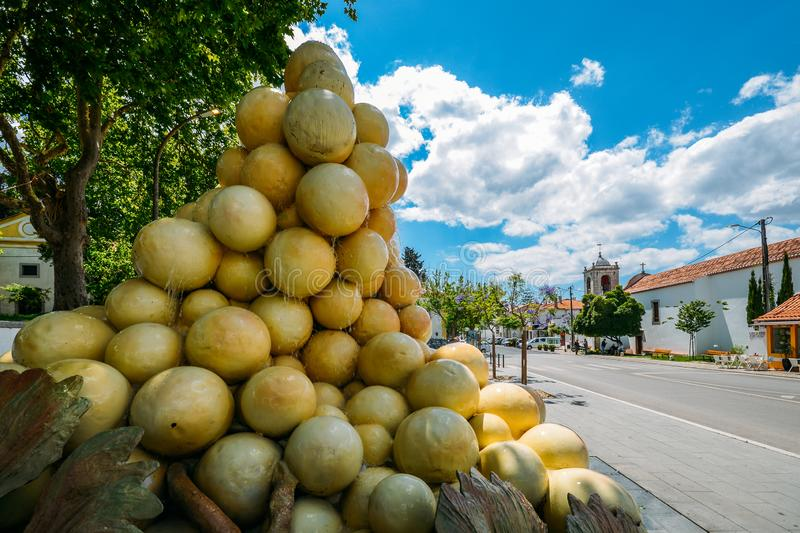 Sculpture of a giant bunch of grapes with a steady flow of water is trickling down in the town centre of Azeitao. Azeitao, Portugal - June 7, 2019: Sculpture of stock image