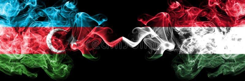 Azerbaijan, Hungr?a, banderas ahumadas coloridas gruesas de la competencia h?ngara Juegos europeos de las calificaciones del f?tb fotos de archivo libres de regalías