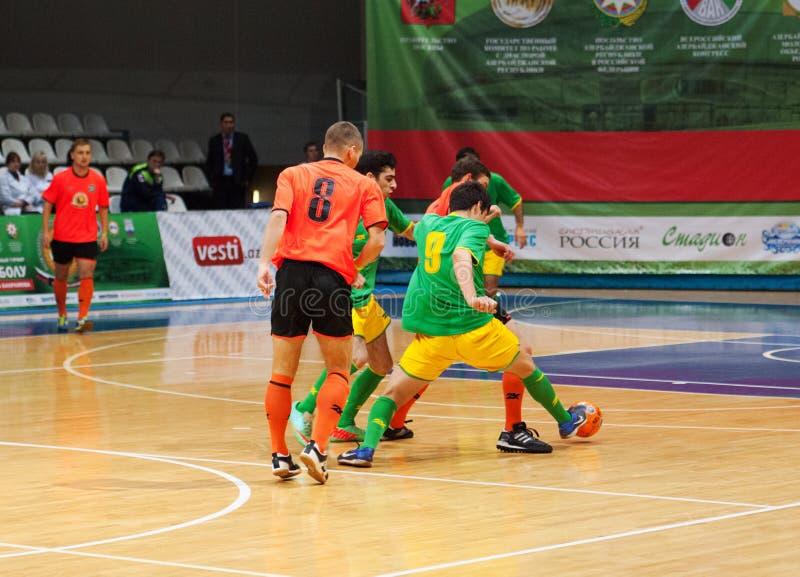 Azerbaijan team (G) and MGKFS team (O) stock images
