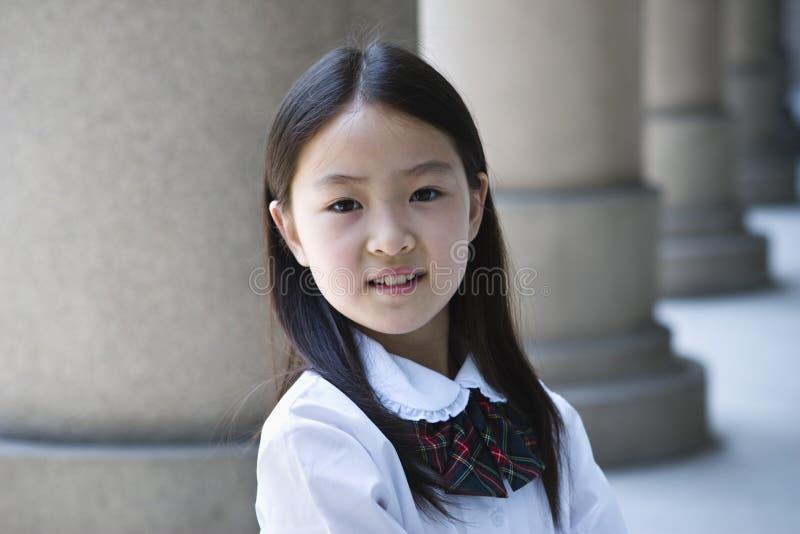 Aziatisch elementair schoolmeisje royalty-vrije stock afbeeldingen