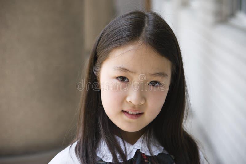 Aziatisch elementair schoolmeisje royalty-vrije stock foto's