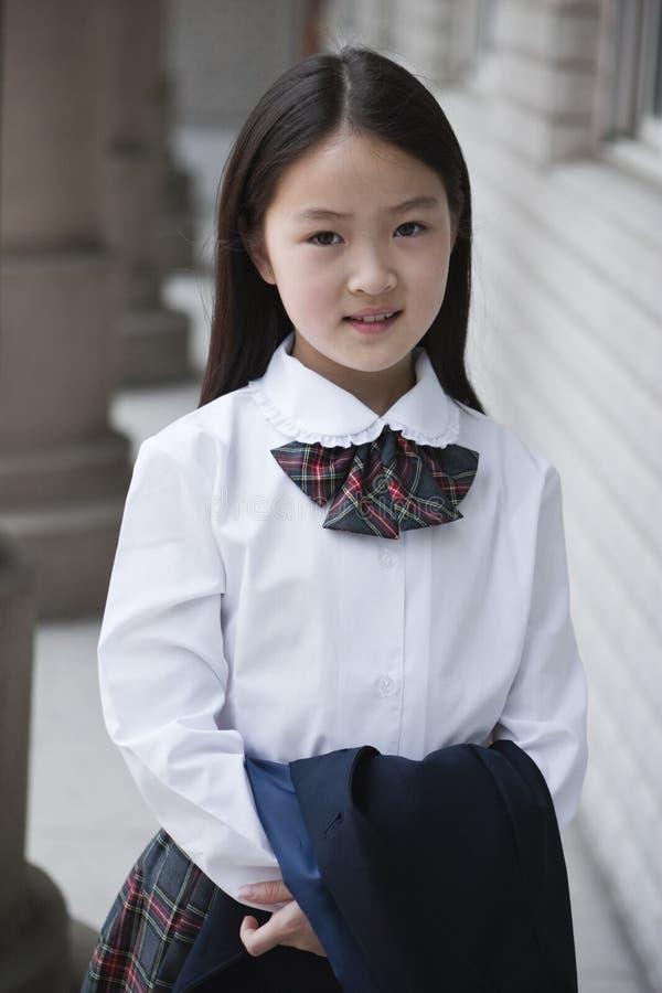 Aziatisch elementair schoolmeisje royalty-vrije stock afbeelding