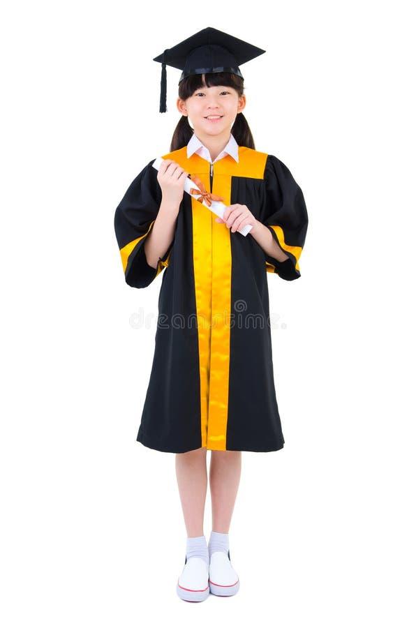 Aziatisch kind in graduatietoga stock foto
