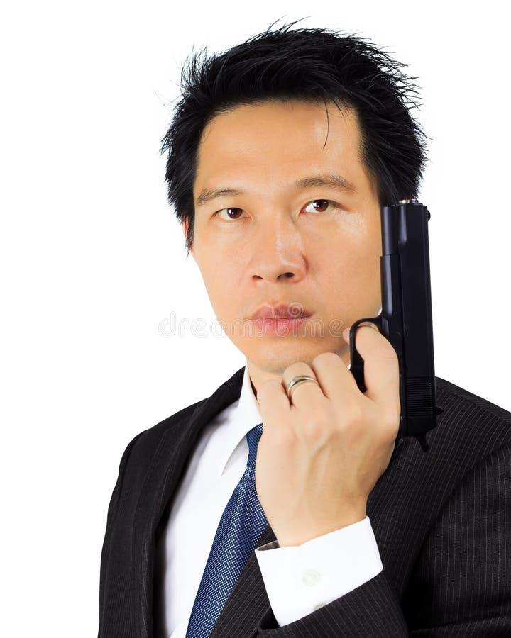Aziatisch mannetje met een kanon op wit royalty-vrije stock foto's