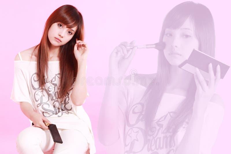 Aziatisch meisje dat omhoog maakt stock afbeelding