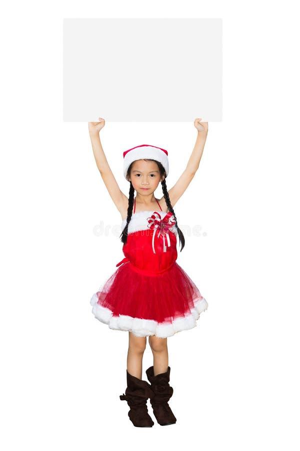 Aziatisch meisje in het kostuum van Kerstmis met lege banner stock afbeeldingen