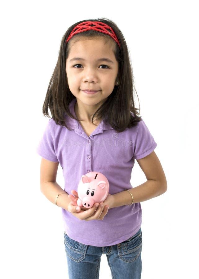 Aziatisch Meisje met Spaarvarken stock foto's