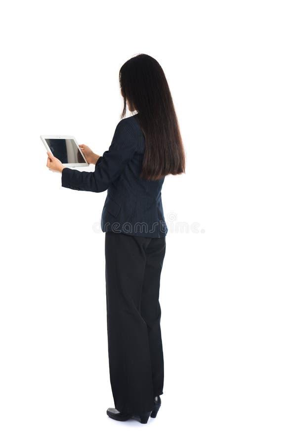 Aziatisch meisje met tablet stock afbeelding