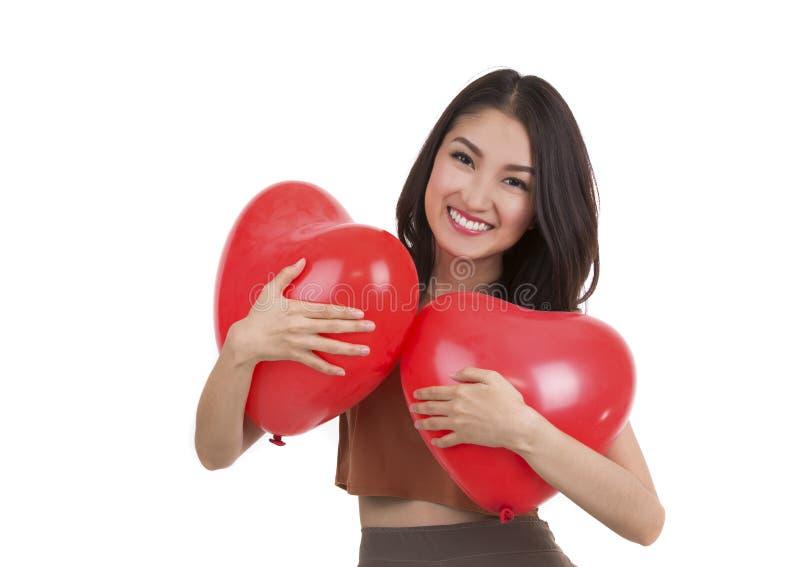 Aziatisch mooi meisje en een rood hart royalty-vrije stock foto's