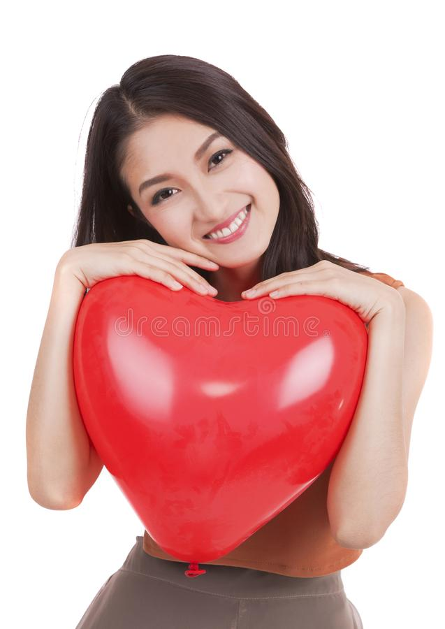 Aziatisch mooi meisje en een rood hart stock fotografie