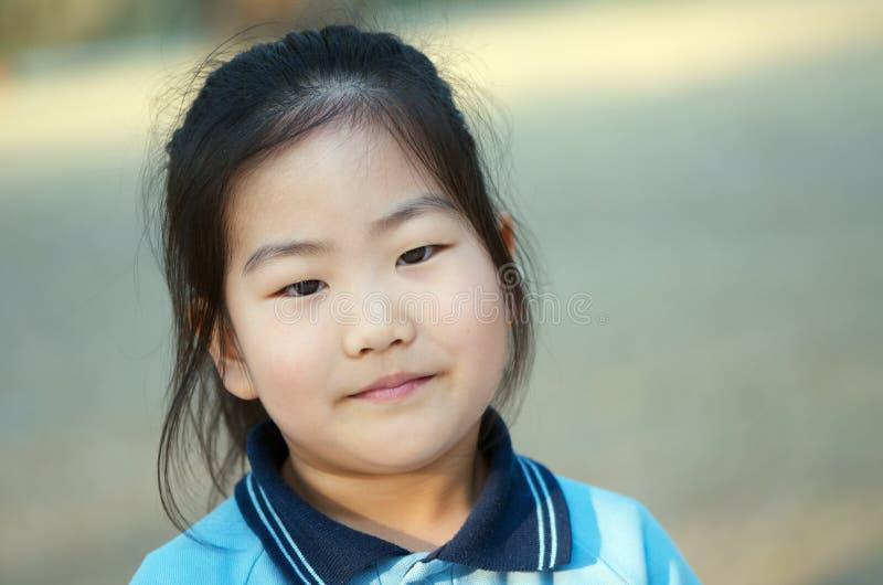 Aziatisch schoolmeisje royalty-vrije stock fotografie