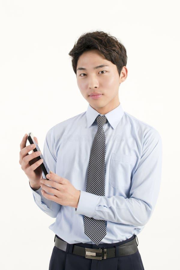Aziatische bankteller met een calculator stock afbeelding