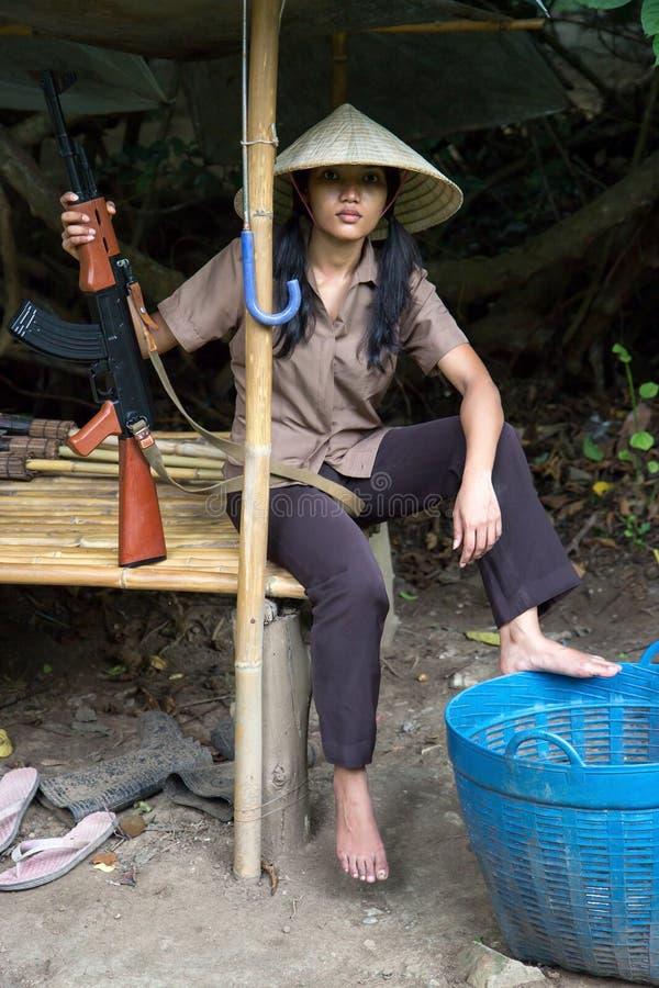 Aziatische bewapende vrouw royalty-vrije stock foto's