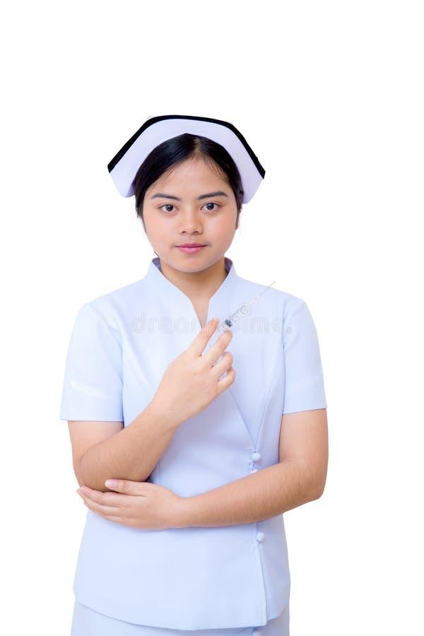 Aziatische de handholding van de verpleegstersvrouw met spuitnaald stock foto