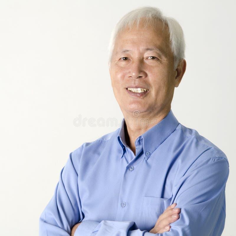 Aziatische hogere zakenman stock fotografie