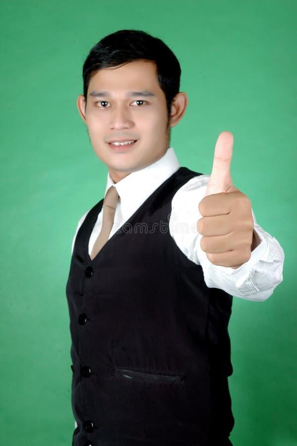 Aziatische jonge mens duim-omhoog royalty-vrije stock afbeeldingen