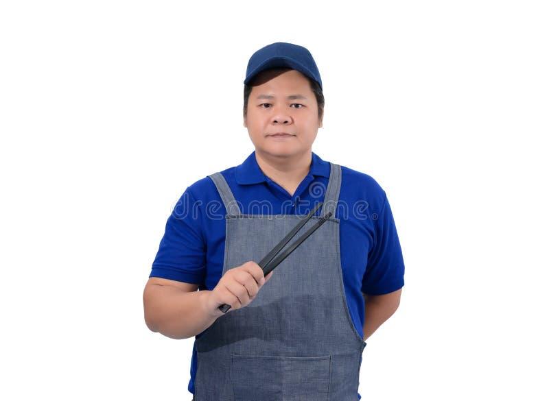 Aziatische Kelner in blauw die overhemd met de holdingstang van de schorthand op wit wordt geïsoleerd stock afbeeldingen