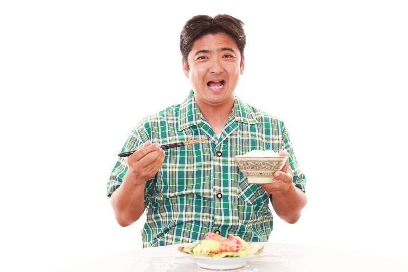 Aziatische mens die ontbijt hebben stock foto