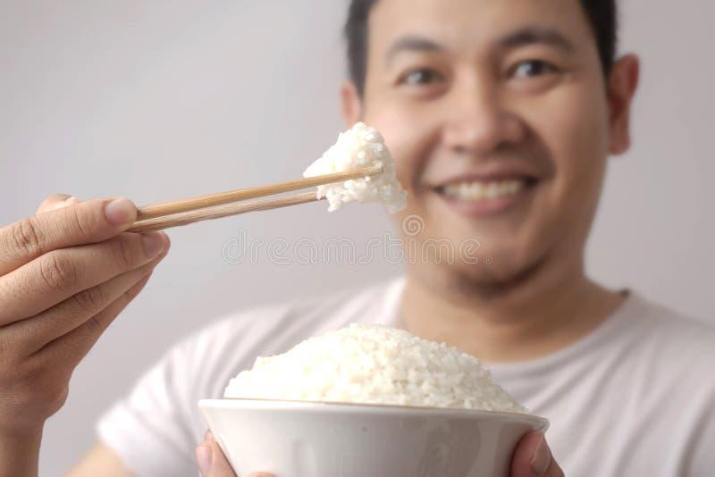 Aziatische Mens die Rijst eten stock afbeeldingen