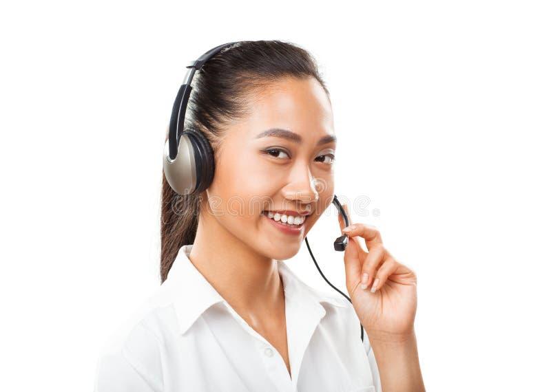Aziatische onderneemster met hoofdtelefoon - agent, afdelingschef, klantenondersteuningsconcept royalty-vrije stock afbeeldingen