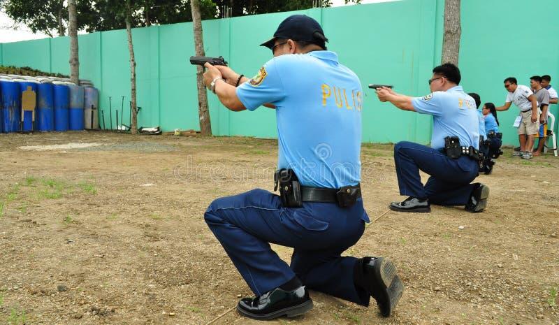 Aziatische politie het ontspruiten praktijk stock afbeelding