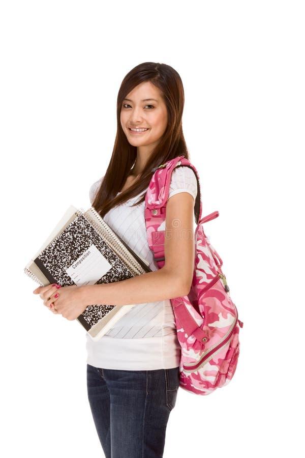 Aziatische student in jeans met rugzak, notitieboekjes royalty-vrije stock foto