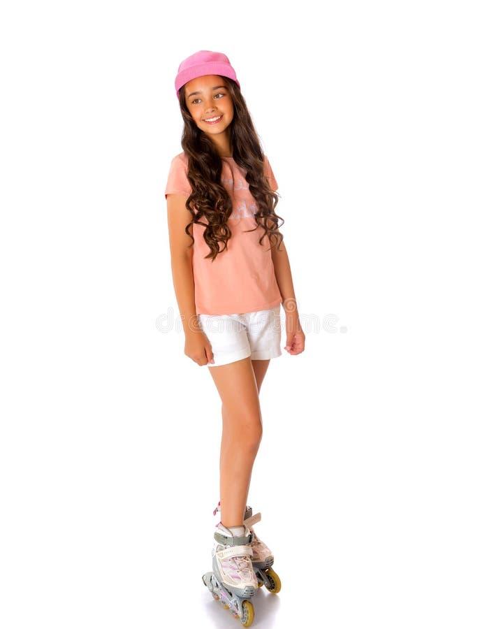 Aziatische tienermeisje rol-schaatst royalty-vrije stock foto