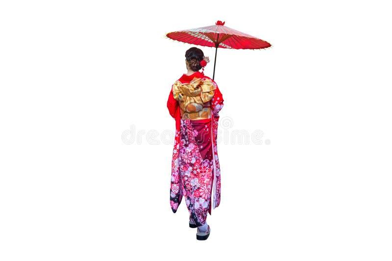 Aziatische vrouw die Japanse traditionele kimono met paraplu op witte backgro dragen und royalty-vrije stock foto's